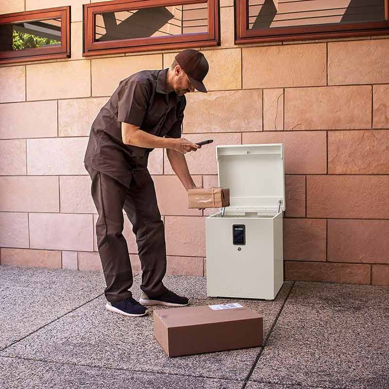 Delivery man using the clevermade parcel drop box