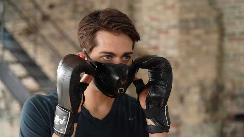 Man wearing the C9 mask exercising