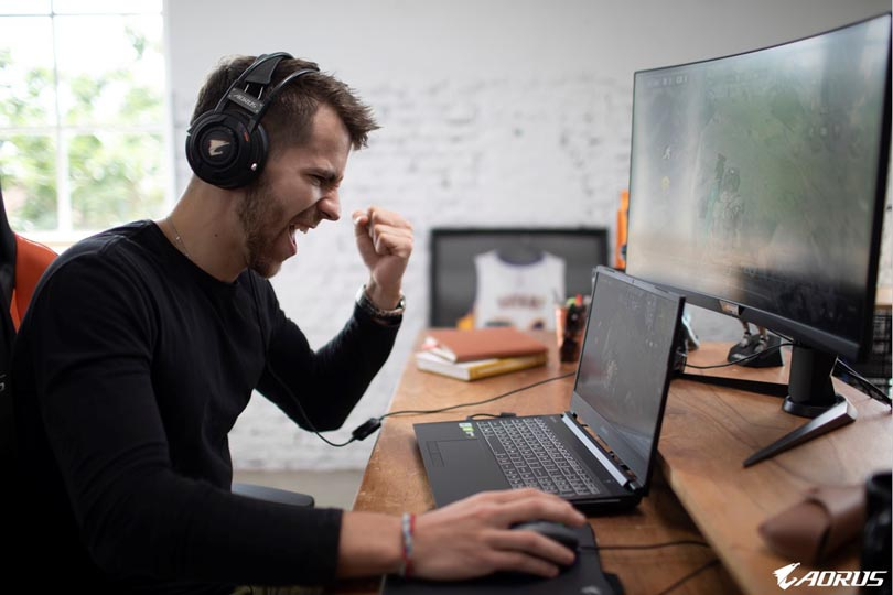 Man playing laptop