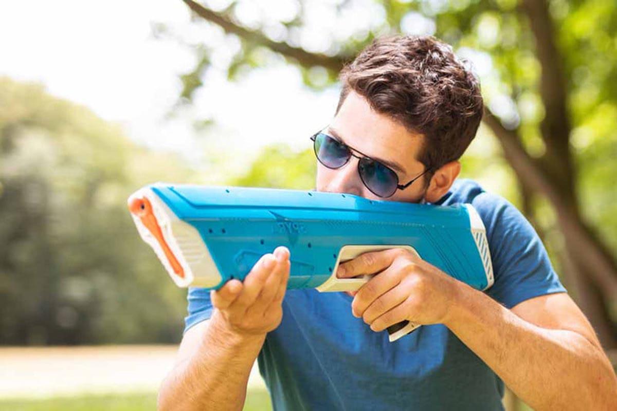 Spyra One Water Gun Being Used by Man