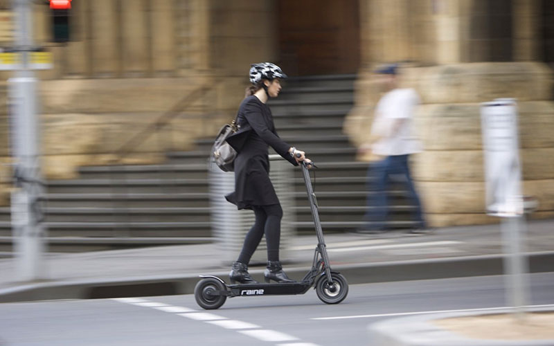 Electric Scooter Benefits - Woman Riding E-Scooter
