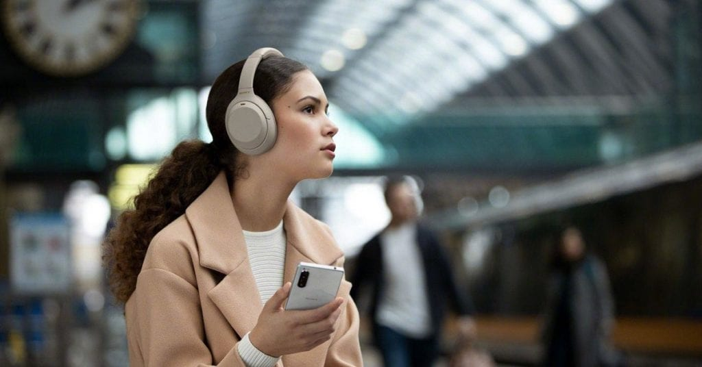 Woman listening to Sony WH-1000XM4
